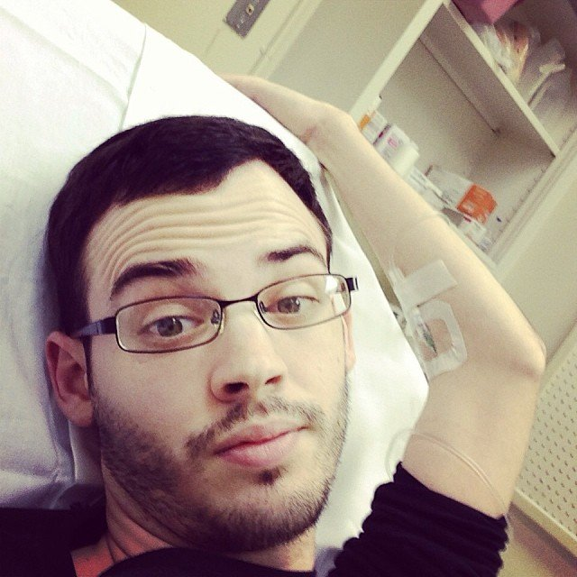 "Here is a Aaron Blocker in the hospital on Fe. 9th: ""At the hospital. Crohn's flaring and possible appendicitis. Just living the #IBD life that we all know so well."""